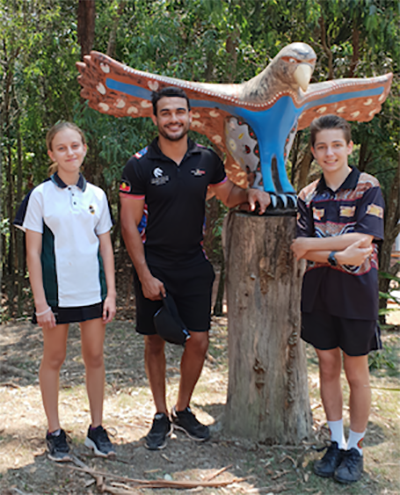 Students with Wollotuka staff and eagle statue