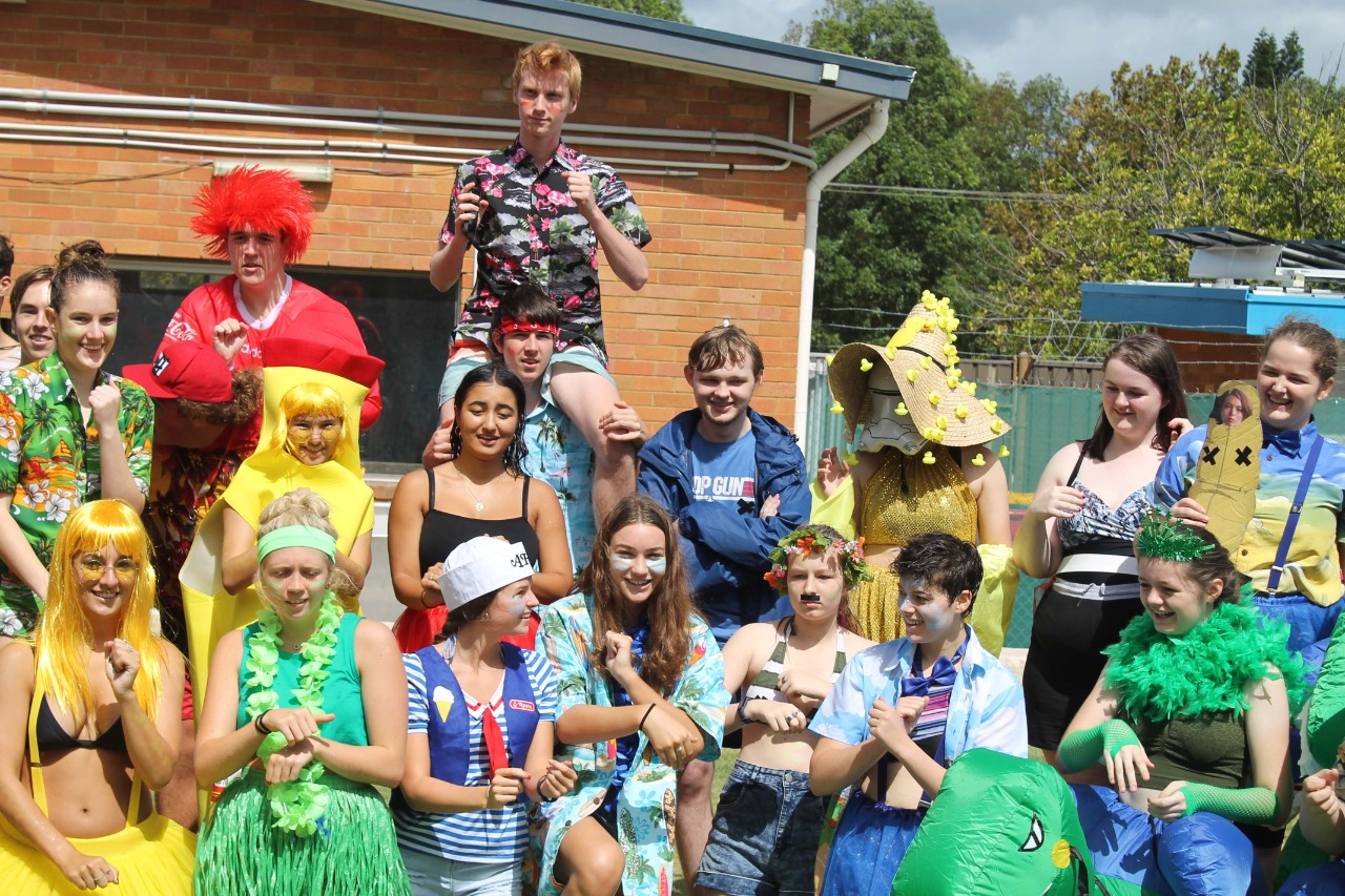 colourful students at swimming carnival in house colours